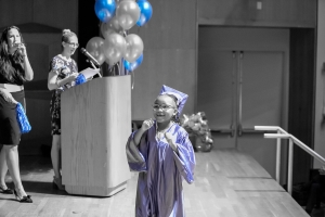 Little girl graduating on stage